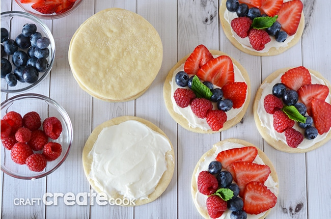 These fruit pizzas are quick and easy to make and will look gorgeous and taste amazing at your Memorial Day, Fourth of July or summer barbecue outing this summer!