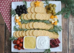 If you are entertaining or bringing a dish to pass this holiday season, this RITZ Crackers Christmas tree is the perfect holiday appetizer to share!