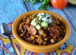 Our Chicken Mexican Stew is a hearty slow cooker meal that's easy to make and is bursting with flavor!