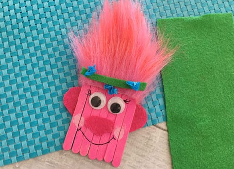 This Trolls Poppy Popsicle Stick Craft for Kids will have you thinking it's all cupcakes and rainbows in no time.
