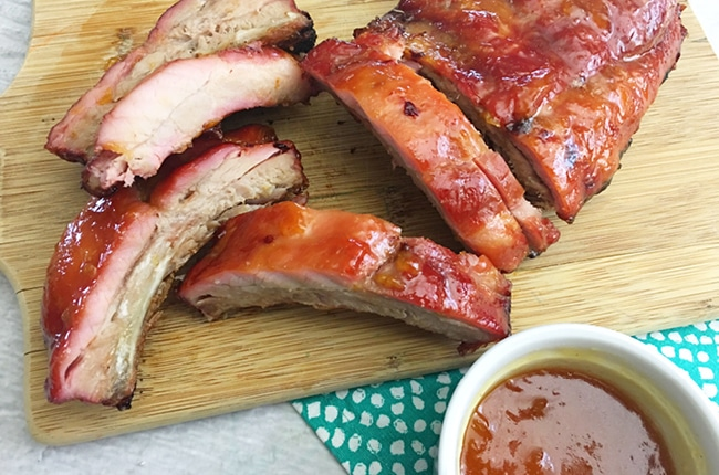 These Extra Tender Peach Ginger Charcoal Grilled Ribs will make your mouth water just by looking them.