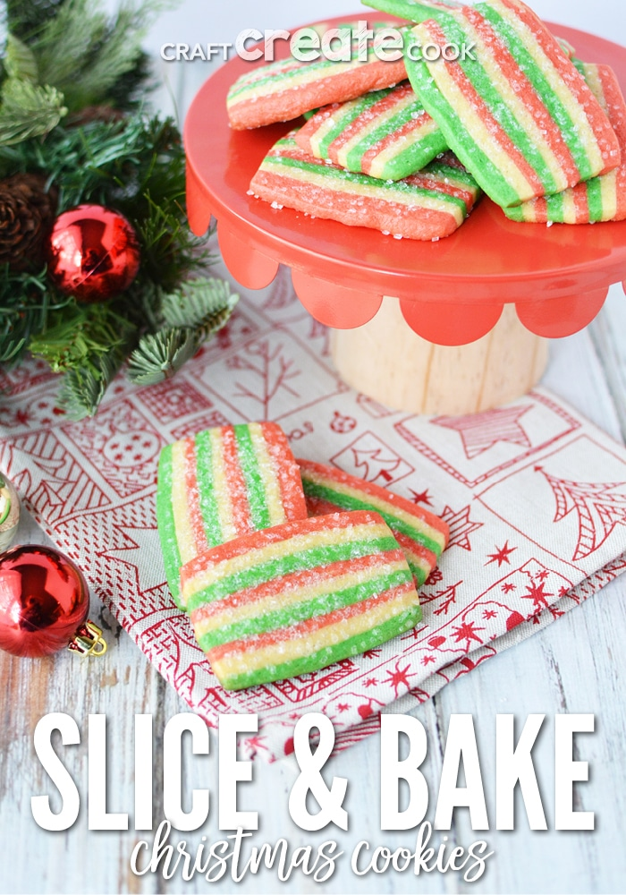 Holiday colored slice and bake cookie sitting on a holiday paper with a red cake stand in background