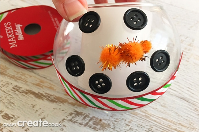 This DIY Winter Snowman Candle Craft will not only look festive, it will have your house smelly great in no time.a