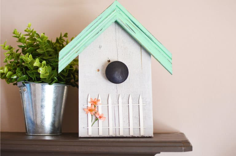 Our decorative birdhouse pallet project is a great way to reuse scrap wood and picture frames as well as add some fun to your home!