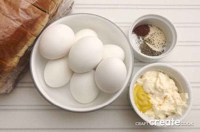 Egg Salad Sandwich Recipe ingredients placed on a desk.