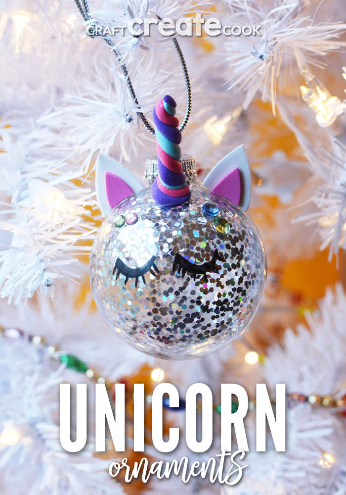 Up close picture of a unicorn ornament on a white holiday tree