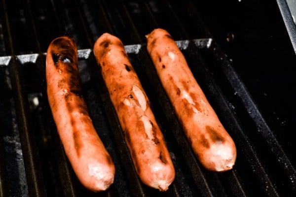 Hot dog grilling.