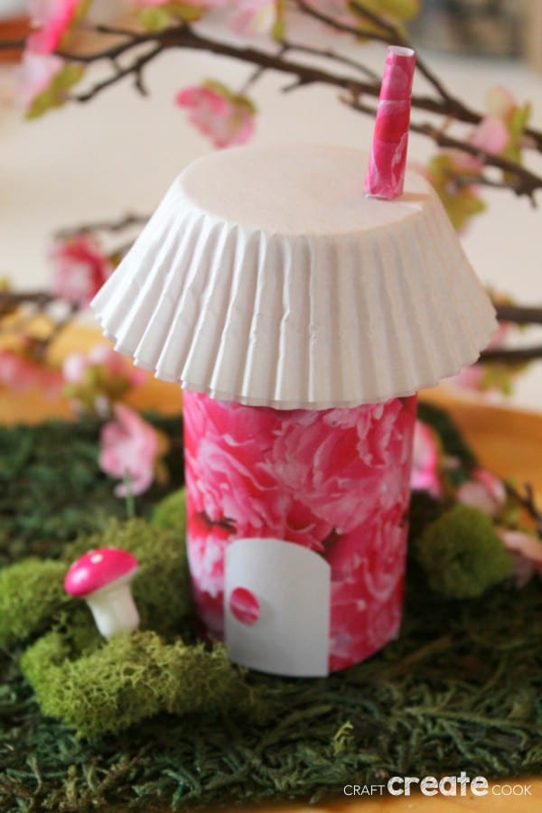 Fairy house with pink exterior and white cupcake liner roof