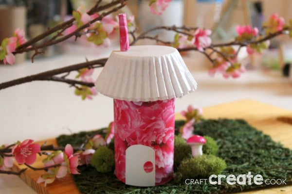 Pink fairy house on fake green grass
