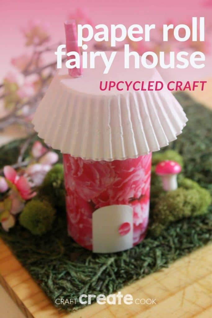 Pink cardboard fairy house on fake grass