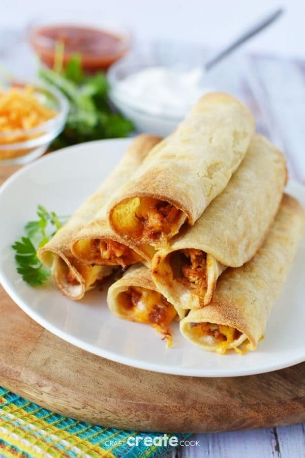 Chicken taquitos on a white plate