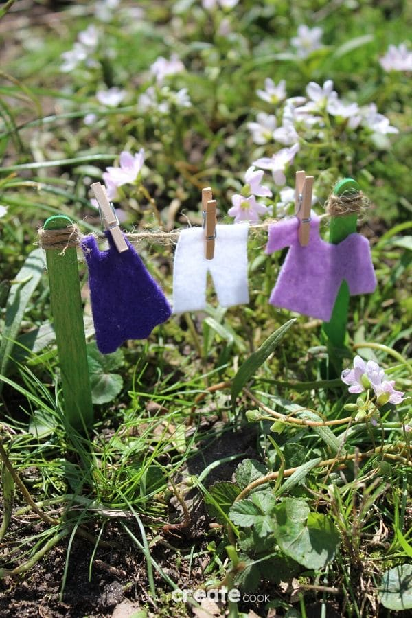 Fairy garden clotheline with purple clothing