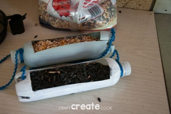 Plastic bottle bird feeder with seed