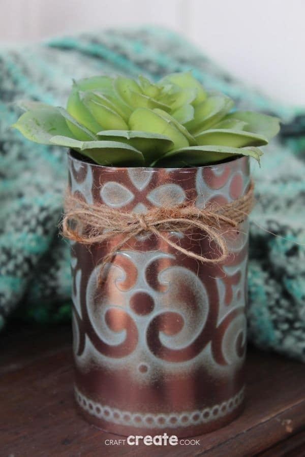 Faux copper tin can planter on wood table