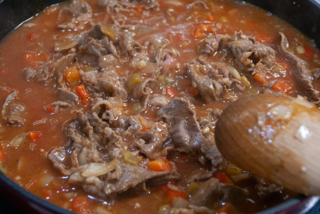 Tomato sauce in skillet with meat