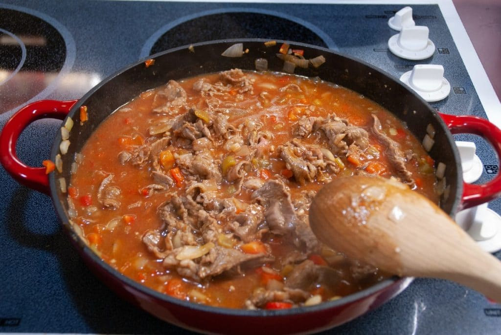 Tomato sauce with beef in skillet