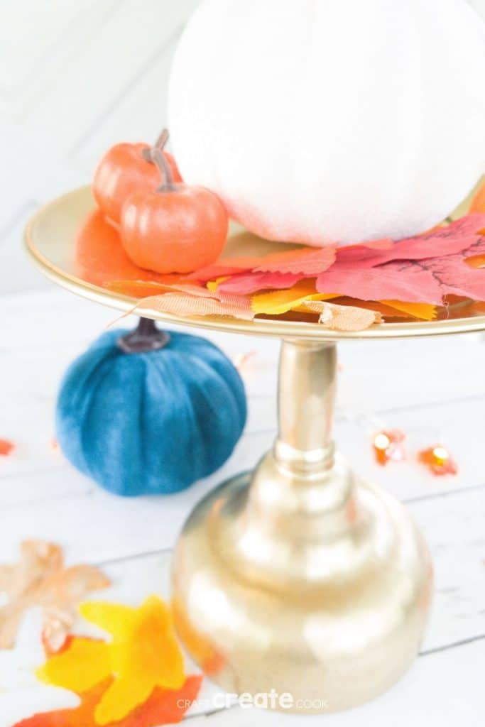 Gold stand with pumpkin and leaves
