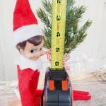 Elf on the shelf with tape measure