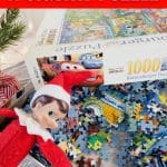 Elf on the Shelf laying in puzzle pieces
