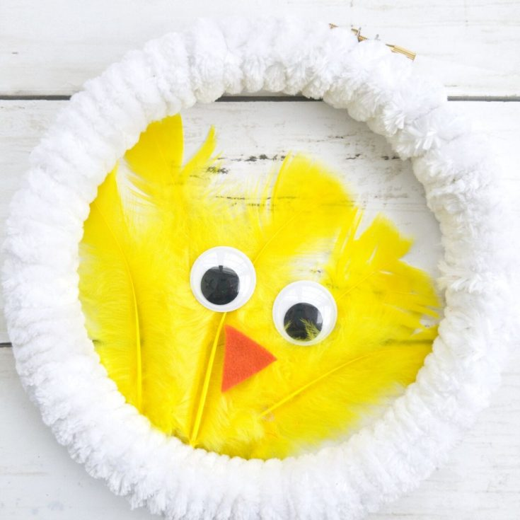 White wreath with yellow feather chicken in center
