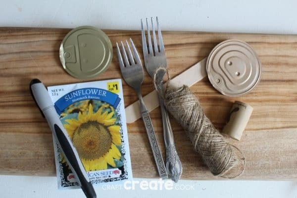 Supplies for garden markers on cutting board