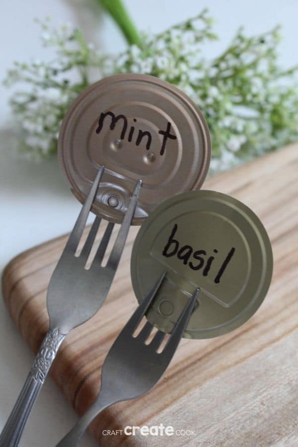 Fork garden markers leaning against cutting board